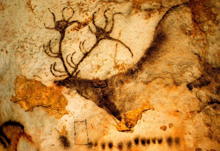 In the famous French cave of Lascaux, ancient artists did more than decorate the walls with images of animals. They also left mysterious geometric signs such as the black quadrangle and dots below this Ice Age deer.